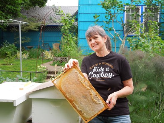 Mary Ann Aschenbrenner with a frame of capped honey.
