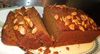 Sliced honey pumpkin bread with pumpkin seeds.