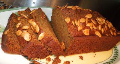 Sliced honey pumpkin bread with pumpkin seeds.